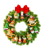 Christmas wreath decorated with ornaments and red ribbon bow Royalty Free Stock Photos
