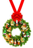 Christmas wreath decorated with ornaments and red ribbon bow Stock Photography