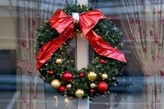 Christmas wreath decorated with red ribbon and Christmas decorations. royalty free stock photography