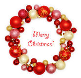 Christmas wreath decoration. From red and golden color baubles on white background Royalty Free Stock Photo
