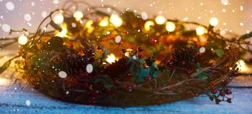 Christmas wreath, decoration with bokeh lights on old white wooden board stock photography
