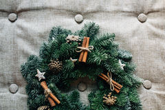 Christmas wreath with decoration  cinnamon on grey. Christmas wreath with decoration  cinnamon on a cotton pillow. Selective focus, copy space background, top Stock Images