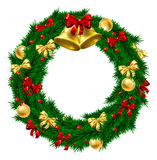 Christmas Wreath Decoration. A Christmas door wreath decoration with gold and red bows and ribbons, holly berries, gold bauble decorations and gold bells Stock Photo