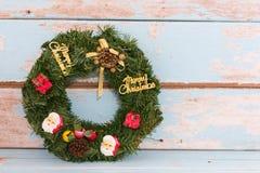 Christmas wreath decoration on retro grunge blue wooden background Stock Photography