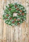 Christmas wreath decoration wooden background. Christmas wreath on wooden background. Christmas decoration royalty free stock photos