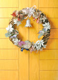 Christmas Wreath decoration at wooden door Stock Photography