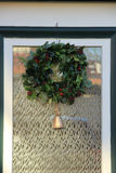 Christmas wreath with decorations on a door Royalty Free Stock Photography
