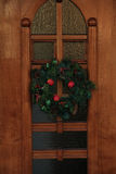 Christmas wreath with decorations on a door Stock Photos