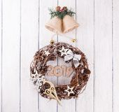 Christmas wreath with decorations. On white background royalty free stock image