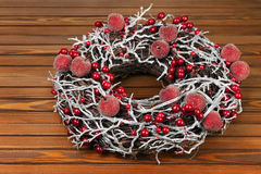 Christmas Wreath with Decorations on Wooden Background. Stock Photos