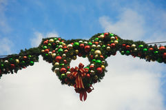 Christmas wreath at Disneyland. Christmas wreath hanging in the air. It creates the shape of Mickey Mouse Royalty Free Stock Photos