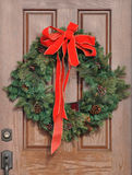 Christmas Wreath on a Door Stock Photo
