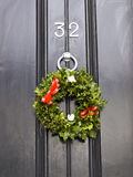 Christmas wreath on door Royalty Free Stock Photography