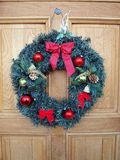 Christmas wreath on door Royalty Free Stock Images