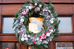 Christmas wreath on the door. Beautiful green Christmas wreath on the door Stock Images