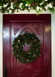 Christmas wreath on the door. royalty free stock photos