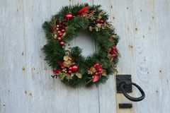 Christmas wreath with door knocker Stock Images
