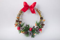 Christmas wreath on the door with a lamp.  royalty free stock images