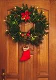 Christmas wreath on door stock photography
