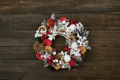 Christmas wreath on door. Christmas wreath on a rustic wooden front door royalty free stock image
