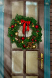Christmas wreath on the door stock photography