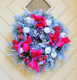 Christmas wreath on door. Christmas wreath on wooden door stock image