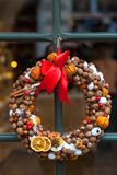Christmas wreath with dried fruit on the door. Christmas wreath decoration with dried orange fruit, cinnamon sticks, mandarin, nuts and coffee beans stock photos