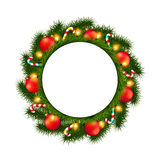 Christmas wreath with empty round frame isolated on white Royalty Free Stock Photography