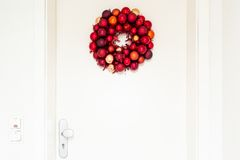 Christmas wreath on entrance door Stock Images