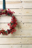 Christmas wreath of evergreen and nandian network berries Stock Photo