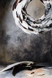 Christmas wreath of feathers on a gray background with divorces Royalty Free Stock Photos