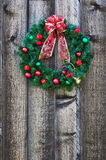 Christmas wreath on fence Stock Photos