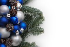 Christmas Wreath with Fir Branches. blue and Silver Balls or Cristmas Globes Decorated with Pinecones. Isolated with Copy Space. Christmas Wreath with Fir stock images