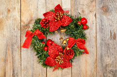 Christmas wreath of fir branches with bows and floral decoration Royalty Free Stock Photos