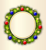 Christmas wreath of fir branches. Card background with a Christmas wreath of fir branches decorated with toysn Royalty Free Stock Photo