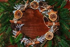 Christmas wreath of fir branches with cinnamon and orange slices Stock Photo
