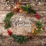 Christmas wreath of Fir branches, cones, red decoration on wooden background with snowflakes. Xmas and Happy New Year theme. Flat lay, top view stock illustration