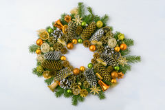 Christmas wreath with fir branches, pine cones and golden orname Stock Photos