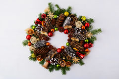 Christmas wreath with fir branches, pine cones and jingle bells Royalty Free Stock Photo