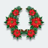 Christmas wreath of fir branches and poinsettias. Stock Photo
