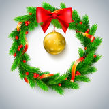 Christmas wreath, fir branches, red berries and bow, golden ribbon Royalty Free Stock Photos
