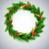 Christmas wreath, fir branches, red berries, golden ribbon Royalty Free Stock Photo