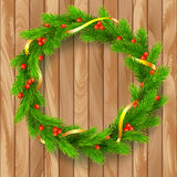 Christmas wreath, fir branches, red berries, golden ribbon. Traditional Christmas wreath made of green fir branches with red berries of viburnum, Golden ribbon Stock Photo