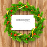 Christmas wreath, fir branches, red berries, golden ribbon. Traditional Christmas wreath made of green fir branches with red berries of viburnum, Golden ribbon Royalty Free Stock Photos