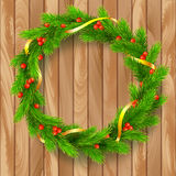 Christmas wreath, fir branches, red berries, golden ribbon. Traditional Christmas wreath made of green fir branches with red berries of viburnum, Golden ribbon Stock Photos