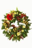 Christmas wreath with flowers and Christmas jewelery, ribbons an Stock Photos