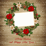 Christmas wreath with frame on wooden background Stock Photos