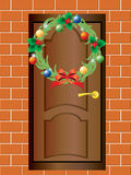 Christmas wreath and the front door. Royalty Free Stock Photo