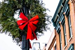 Christmas wreath with garland hanging on lantern pillar royalty free stock photo