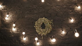 Christmas wreath with garland on wood wall stock footage